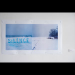 Image of two winter scenes, the left image with white ice letters SILENCE right image tracks in snow with trees